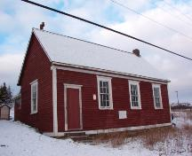 View of western side and main facade of the Otterbury School House, Harbour Grace, NL.  Photo taken November 1, 2005.; Heritage Foundation of Newfoundland and Labrador, 2004