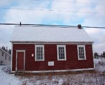 View of main facade which overlooks the harbour, Otterbury Schoolhouse, Water Street, Harbour Grace, NL.  Photo taken November 1, 2005.; HFNL/ Deborah O'Rielly 2005.