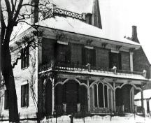 "This photo, which was taken in the 1930's, shows the original ""widow's walk"" roof and verandah balustrade.; Moncton Museum"