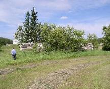 View west at remnant stone walls, 2004.; Government of Saskatchewan, Marvin Thomas, 2004.