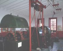 Interior view of Victoria Hydro-Electric Station showing wheel turbines 1 and 2.  Photo taken December 2005.; HFNL/ Dale Jarvis 2005.