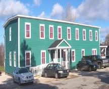 Exterior view of front and right facades, International Pulp and Paper Company Staff House, Deer Lake, NL, after restoration was completed.; HFNL 2005