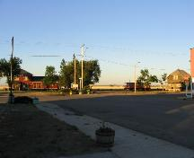 View south at station, caboose and house on heritage park site at end of Main Street, 2005.; Government of Saskatchewan, Marvin Thomas, 2005.