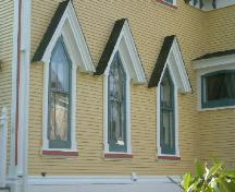 An oblique view of windows on the north side of the rear section of the Job Hatfield House, Yarmouth, NS, 2006.; Heritage Division, NS Dept. of Tourism, Culture and Heritage, 2006.