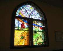 Unique stained glass window depicting four typical prairie scenes, 2004.; Government of Saskatchewan, Jennifer Bisson, 2004.