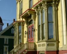 A detailed view of the bay windows and front entrance of the George and Mary Ellen Guest House, Yarmouth, NS, 2006.; Heritage Division, NS Dept. of Tourism, Culture and Heritage, 2006