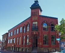 The Transcript Building, now law offices, sits on the south side of Main Street where its tower is still a prominent feature of the streetscape.; Moncton Museum