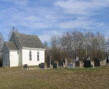 View of church and cemetery, 2005.; Government of Saskatchewan, J. Kasperski, 2005.