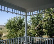Image of verandah detail in foreground; view of surrounding valley and landscape in background, 2005.; Government of Saskatchewan, Lindy Thorsen, 2005.