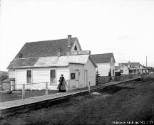 Looking down the sidewalk, the Roland Michener House is the third building, near the powerpole (circa 1910)