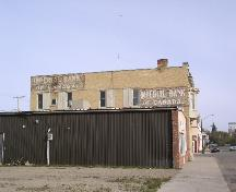 View of south façade, showing original bank signage, 2003.; Government of Saskatchewan, Jennifer Bisson, 2003.