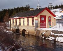 Exterior photo of Port Union Hydro-Electric Station; view of building showing water source which travels below the station. Photo taken January 2006.; HFNL/ Lara Maynard 2006.