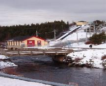 Exterior view of power generating plant, river, flume and substation, Port Union, NL. Taken January, 2006.; HFNL/ Lara Maynard 2006.