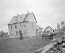 Bishop's residence and fields at Fort Smith Mission Historic Park, 1922; Canada. Department of the Interior/NWT Archives