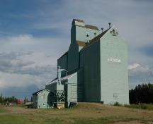 Alberta Wheat Pool Grain Elevator Site Complex Provincial Historic Resource, Andrew - elevator flanked by two annexes and adjacent manager's office (September 2005); Alberta Culture and Community Spirit, Historic Resources Management Branch, 2005