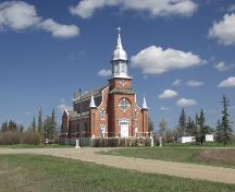 St. Norbert's Roman Catholic Church, as seen from the southwest, dominates the intersection of two rural roads near Provost (April 2003); Alberta Culture and Community Spirit, Historic Resources Management Branch, 2003