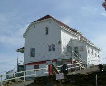 A northwest perspective of the lightkeepers' dwelling at the Cape Forchu Lightstation, Cape Forchu, Yarmouth County, NS, 2006.; Heritage Division, NS Dept. of Tourism, Culture & Heritage, 2006