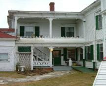 The two storey veranda on the west side of the north ell of Churchill Mansion, Darling's Lake, Yarmouth County, NS, 2006.; Heritage Division, NS Dept. of Tourism, Culture & Heritage, 2006