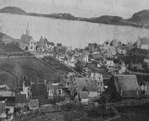 Historic view of Trinity, Trinity Bay, NL from Gun Hill, including St. Paul's and Holy Trinity churches, looking towards Trinity Harbour, with Admiral's Point in the background, circa 1950.; Trinity Historical Society Archives