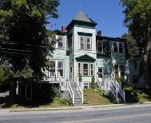 James Simmonds House, projecting two storey square bay with pediment over three paned first storey window, hooded second storey double window, street level basement, Dartmouth, Nova Scotia, 2005.; Heritage Division, NS Dept. of Tourism, Culture and Heritage, 2005