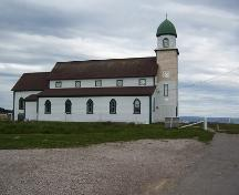 Exterior photo, north facade, Holy Trinity Church, Codroy, Newfoundland, 2006, showing restoration work in progress.; HFNL 2006