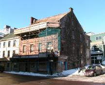 Exterior photo of Yellow Belly Corner, shown during restoration work, photo circa 2005.; HFNL 2006