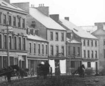 Detail of a historic photo of Water Street, St. John's, showing Yellow Belly Corner at the right of the photo, the last building in the row. Date unknown.; City of St. John's Archives photo number 04-21-014, copyright 2006.