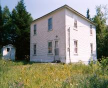 Exterior view of Stanley Ford House showing front and right sides, with storage shed at left, Jackson's Arm, NL, 2005.; Town of Jackon's Arm, 2005.