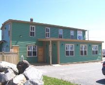 Southeast facing view of the front facade, Bernard Kavanagh Premises, Ferryland, NL. Photo taken May 2006. ; HFNL/Andrea O'Brien 2006