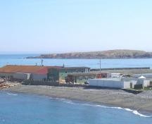 View of the Bernard Kavanagh Premises, Ferryland, NL looking southeast from the Southern Shore Highway. Photo taken May 2006. ; HFNL/Andrea O'Brien 2006