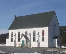 Looking north to view of side and front facade of St. Charles Borromeo Church, Fermeuse, NL. Photo taken April 2006.; 2006 HFNL/Andrea O'Brien