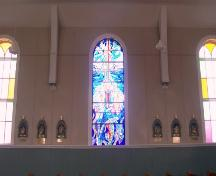 Interior view of recent stained glass flanked by original stained glass in St. Charles Borromeo Church, Fermeuse, NL. Photo taken April 2006.; 2006 HFNL/Andrea O'Brien