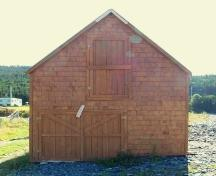 Exterior view of Burgess Stage, Whiteway, Trinity Bay, NL showing the upper loft door and lower double door.  Photo taken September 8, 2005.; HFNL 2005