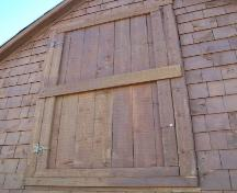 Close up view of the loft door, Burgess Fishing Property.  Photo taken September 8, 2005.; HFNL 2005