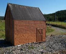 View of ocean-facing side of Burgess Fishing Property showing access door on front, the loft and double barn doors are on the left facade.  Photo taken September 8, 2005.; HFNL 2005