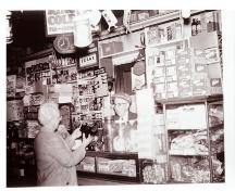 Showing interior when it operated as a general store, ca. 1950s or 1960s; Lighthouse Museum Collection