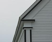 Detail showing return eaves and corner board designed as a Greek pilaster with a simple capital.  Saint Andrews Presbyterian Church, Rose Bay, Lunenburg County, Nova Scotia, 2006.; Heritage Division, Nova Scotia Department of Tourism, Culture and Heritage, 2006.