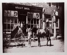Scene in front of store - note gas pumps and horses!; Private collection, n.d.