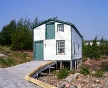 View of front facade of the Grenfell Shed and Wharf in Mary's Harbour, view looking landward. ; Town of Mary's Harbour 2006