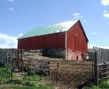 View of Ontario-style bank barn built into the side of the hill, and surrounding farm yard, 2005.; Lindy Thorsen, 2005.