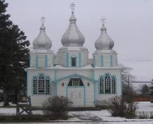 View of east elevation of Holy Trinity Ukrainian Greek Orthodox Church, east elevation featuring the entryway and spires, 2005.; Government of Saskatchewan, Michael Thome, 2005.