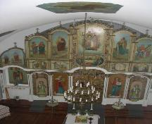 View of interior of church featuring the iconostasis which is richly decorated with Ukrainian Orthodox iconography, 2005.; Government of Saskatchewan, Michael Thome, 2005.