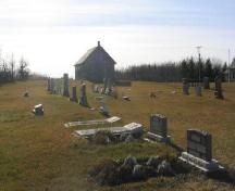 View of Orkney Church from north-east featuring the cemetery, 2005.; Government of Saskatchewan, Michael Thome, 2005.