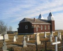 View of church and cemetery at St. Mary's Church and Site from north-west corner of site, 2005.; Government of Saskatchewan, Michael Thome, 2005.