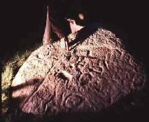 Petroglyphs show prominently under oblique lighting, 1988.; Government of Saskatchewan, 1988.
