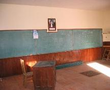 Interior of School looking at the blackboard of Pinto River School.; Clint Robertson, 2006.