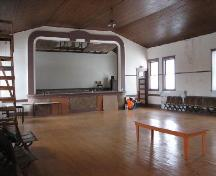 View of the assembly room in  Craik Town Hall featuring the stage, 2006.; Saskatchewan Architectural Heritage Society, Frank Kovermaker, 2006.