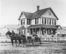 William Cousins house (Sunnyholme) with family members pictured about the yard in front (circa 1900); Esplanade Archives, Medicine Hat, Image 0017.0010
