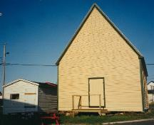 Exterior view of side and rear facade, Bailey's Cove Church of England School, Bonavista; HFNL 1998