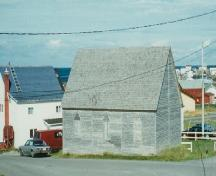 Exterior view of Bailey's Cove Church of England School, Bonavista, NL before restoration; HFNL 1998